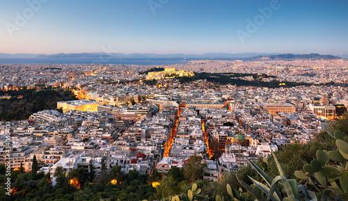 Fotografie, Obraz Cityscape of Athens with illuminated Acropolis hill, Pathenon and sea at night,