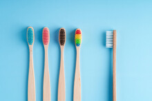 A Bunch Of Eco-friendly Bamboo Toothbrushes. Global Environmental Trends. Gender And Racial Inequality. Toothbrushes Of Different Genders