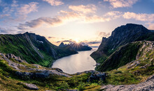 Gorgeous View Of Senja, Norway With The Sun Shining Through Big Clouds