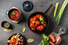 Roasted Meatballs With Tomato Sauce And Parsley In A Frying Pan On Dark Background.