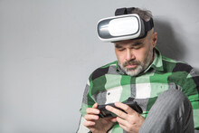 Man In Virtual Reality Glasses Over Grey Backgrou