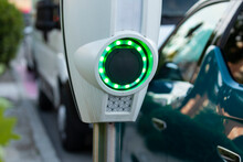 A Battery Charging Point For Electric Cars, Illuminated With Green LEDs, In The Area Of The Retiro District, In Madrid, Spain.