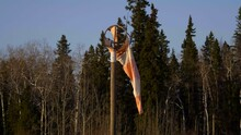 Broken Windbag With Spruce Forest In Background At Fort St. James Airport In British Columbia, Canada. - Medium Shot