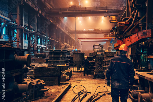 Fotografiet Industrial interior metallurgical factory foundry inside, heavy industry, large workshop metalwork manufacturing, iron casting in molds