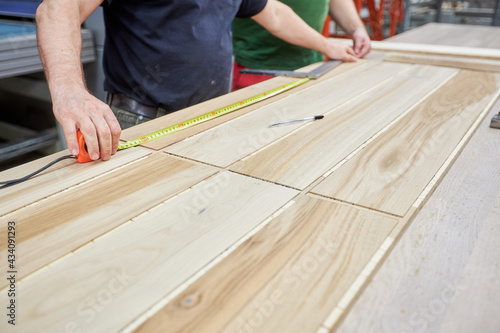 Carpenters working on wood factory with machines Fotobehang