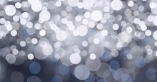 Digital Generated Image Of Spots Of Bokeh Lights Against Grey Background