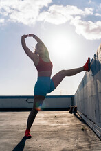 Active Woman Stretching After Training