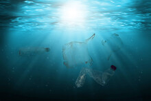 Pollution Of Ocean With Plastic Waste Floating In The Water. Environmental Protection And Ecology Concept.