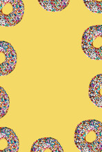 Frame Of Chocolate Glazed Doughnuts With Colorful Sprinkles On Yellow Backdrop