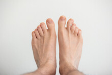 Caucasian Male Bare Feet Top View Close Up Shot Isolated On White