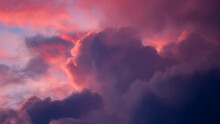 Magenta And Blue Contrasting Intense Vibrant Dramatic Cloudscape Scenery With Clouds Lit Up In Various Shades Against Blazing Sunset. Climate And Weather Condition Backdrop Concept. Wallpaper.
