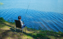 A Child On A Fishing Trip Is Catching Fish In The Summer. Selective Focus.