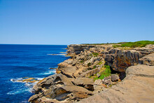 Looking At Rocky And Eroded Cliffs Over The Western Pacific Ocean On The Eastern Coast Of Australia Near Botany Bay South Of Sydney.
