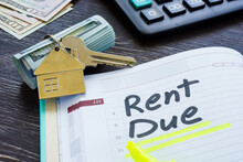 Rent Due Sign In The Planner And Key.