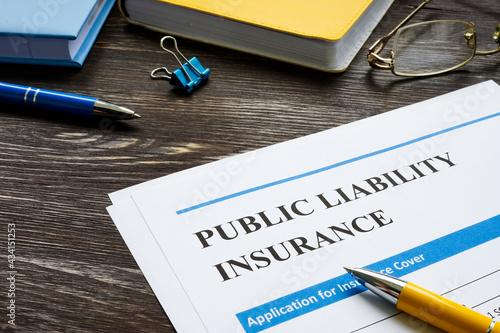 Papel de parede Public liability insurance empty application on wooden surface.