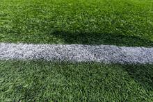 Artificial Grass On A Football Field. Close-up. Background. Texture.