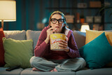 Woman watching a suspense movie - 434165692