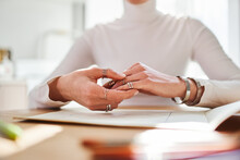 Crop Unrecognizable Female Astrologist In Rings And Bracelets Working At Desk With Paper Album At Home