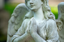 Tender Beautiful Angel Praying. Fragment Of An  Ancient Statue. Selective Focus On Hands.