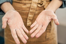 Crop Unrecognizable Female In Apron Showing Palms Of Hands With Flour After Cooking In House