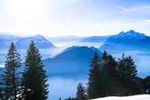 Swiss Alps Mount Pilatus Towering Over Foggy Misty Vierwaldstattersee, Lake Lucern, Switzerland