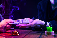 A Fortune Teller Or Oracle Takes Money For Their Work. Psychic Readings And The Concept Of Clairvoyance. Photo With Neon Lighting