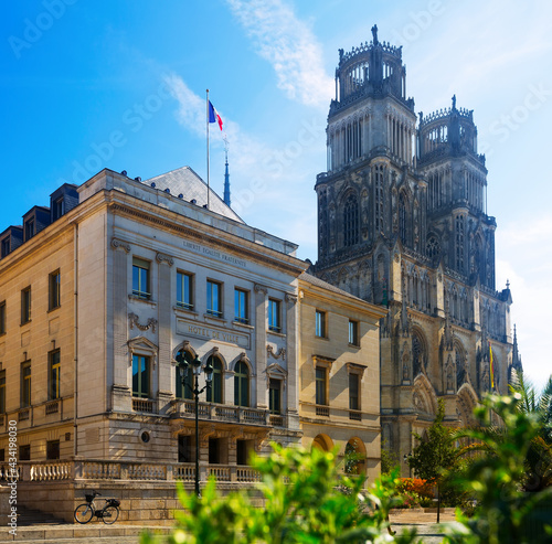 Fototapeta View of Orleans City Hall and Gothic Cathedral of Holy Cross in sunny autumn day, France