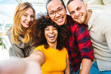Multicultural Group Of Friends Taking A Selfie With African Woman In Foreground - Friendship Concept With Young People Smiling At Camera - Focus On Black Girl