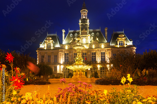 Canvas Impressive architecture of illuminated Limoges City Hall in twilight, France