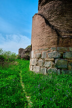 Corner Of The City Wall Of Iznik (nicaea) Bursa. Behind The Red Bricks City Wall And Small Walking Path And Trail Around The Green Grass.