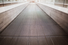 Flat Escalator In A Shopping Mall Without People, Luminous Unfocused Background.