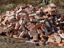 A Pile Of Scattered Red Bricks