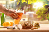 Fototapeta Kawa jest smaczna - Drinking beer in bar restaurant with nature outdoors and snack