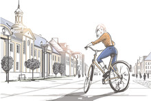 Woman Riding A Bicycle In The City.
