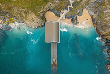 Aerial View Of Padstow Lifeboat Station Along The Coastline, Trevose, Cornwall, United Kingdom.