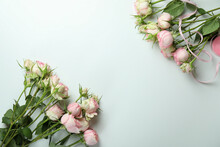 Beautiful Roses And Ribbon On White Background