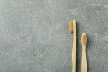 Eco Friendly Wooden Toothbrushes On Gray Background