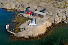 Aerial View Of A Red Boat House With Anchored Boat, Gothenburg Archipelago, Sweden, Scandinavia.