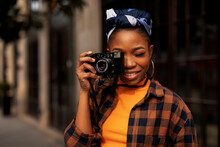 Attractive Tourist With A Camera. Beautiful Woman With Camera Taking Photos Of Beautiful Location.
