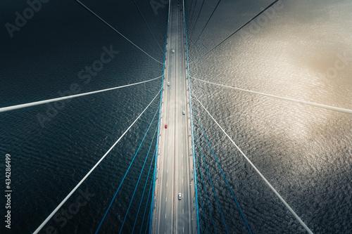 Fototapeta Aerial view of vehicles crossing the Russkiy Most, the main bridge in Vladivostok, Russia