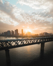 Aerial View Of Wuhan Yangtze River Bridge With City Skyline In Background At Sunset, Wuhan, China.