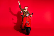 Full Length Photo Of Cheerful Aged Woman Happy Positive Smile Ride Bike Wave Hello Isolated Over Red Color Background
