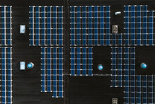 Aerial View Of Solar Panels Infrastructure System On Factory Rooftop In Kaunas, Lithuania.