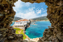 Scenic View Of Sea And Buildings Sen Through Rock Formation Against Sky