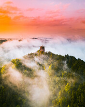 Aerial View Of A Buddhist Temple On Hilltop During A Foggy Day At Sunset, China.