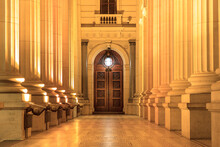Corridor Of Victoria State Parliament Building Pillars In A Row, With A Door At The End