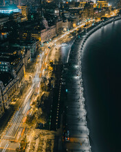 Aerial View Of Shanghai Buildings Along Huangpu River At Night, Shanghai, China.