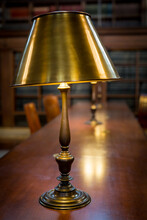 Close-up Of Illuminated Lamp On Table At Library