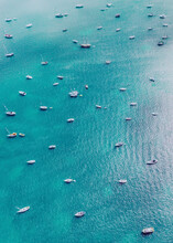 Aerial View Of Several Boats Anchored Along The Atlantic Ocean Shoreline In Miami Beach, Florida, United States.