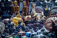 Various Statues For Sale At Market Stall